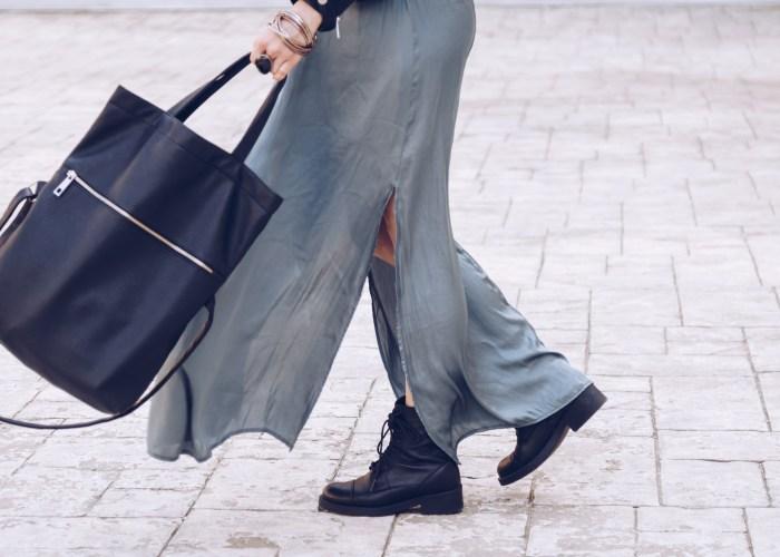 Woman holding a black tote bag - hero