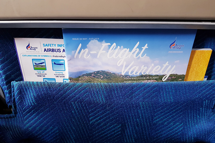 nflight magazine and safety information puts in pocket front of passenger seat