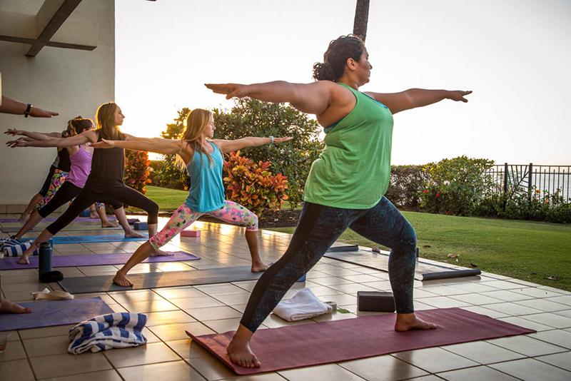women doing yoga in maui