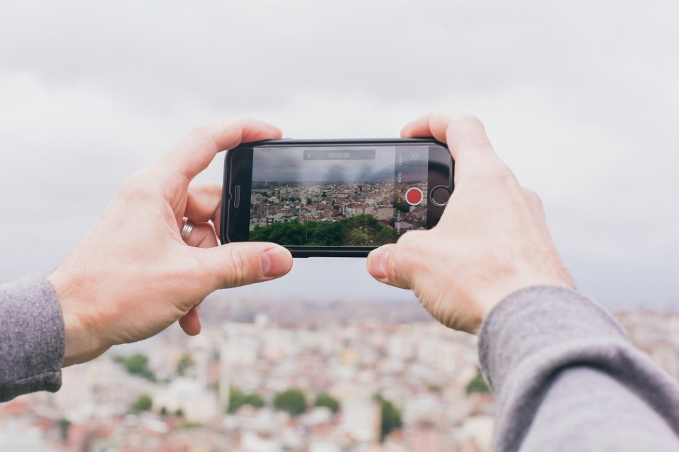 smartphone taking a photo of cityscape