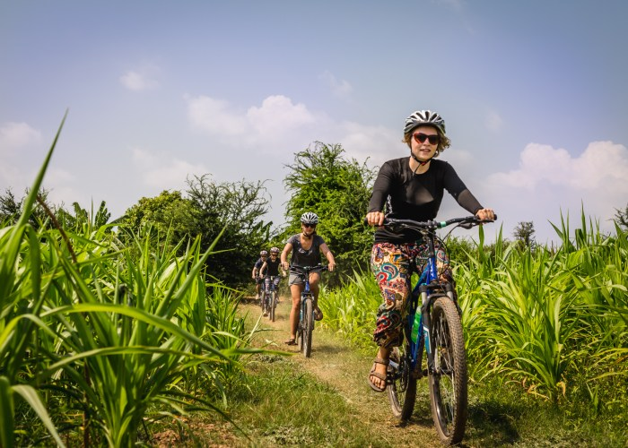 woman riding bike in vietnam on trip