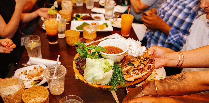 table full of food at vientiane cafe philadelphia.