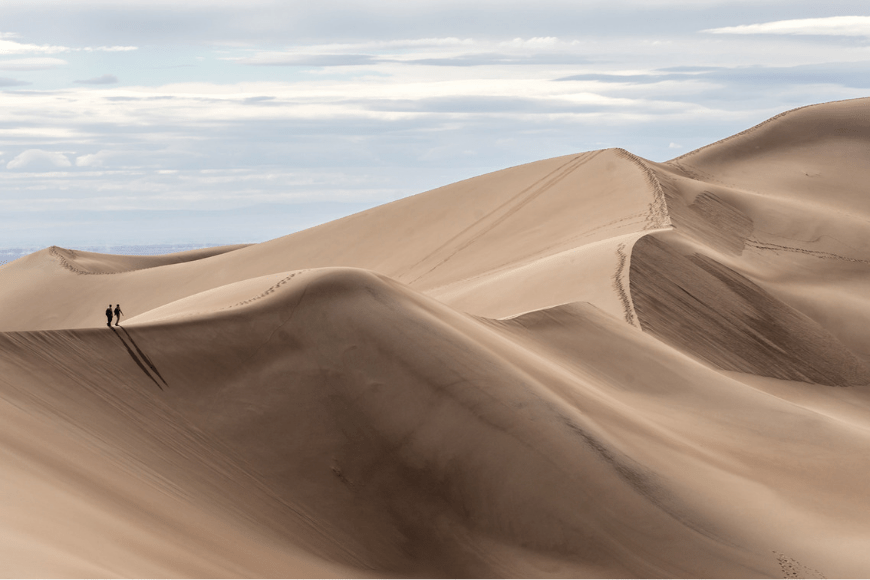 hikers on great sand dune national park.