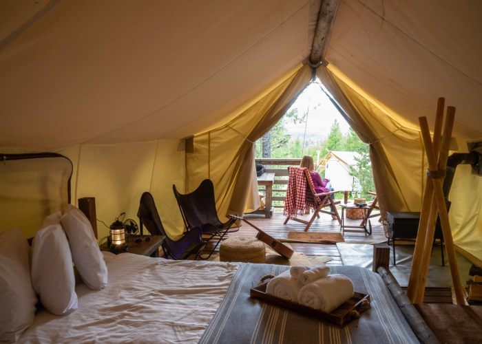 woman-sitting-outside-luxury-tent-on-glamping-trip-in-glacier-national-park