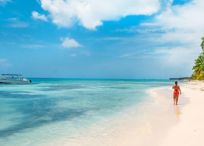 woman walking on caribbean beach.
