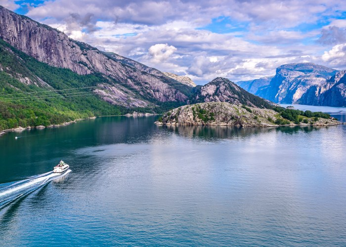wide angle view of boat in norway fjords.