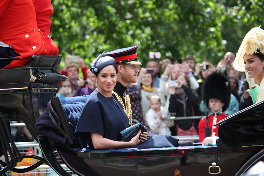 meghan markle in royal carriage with prince harry and kate middleton.