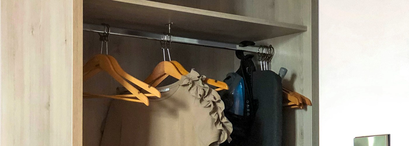 hanging shirt or dress hangers closet hotel room