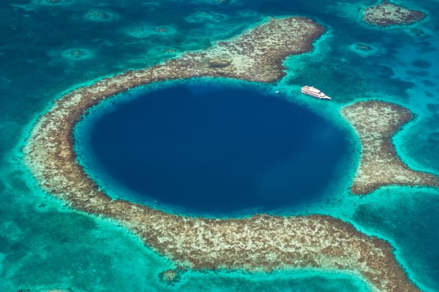 boat on great blue hole belize.
