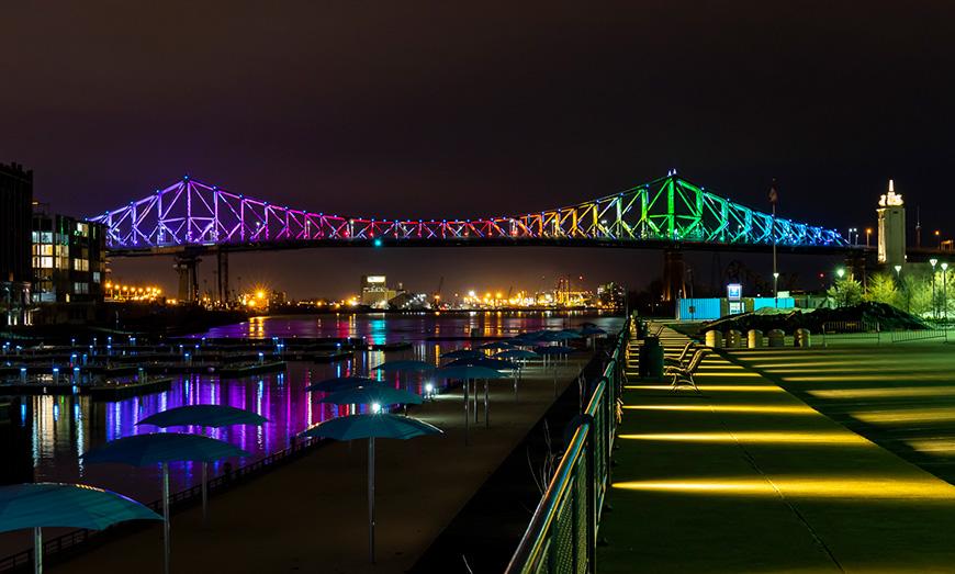 montreal rainbow bridges lit up