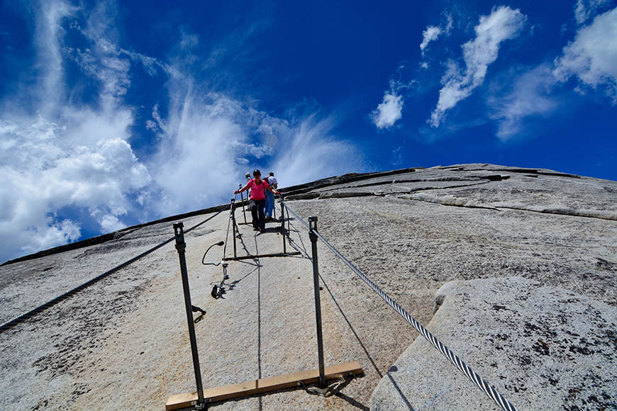 half dome yosemite hikers with cables.