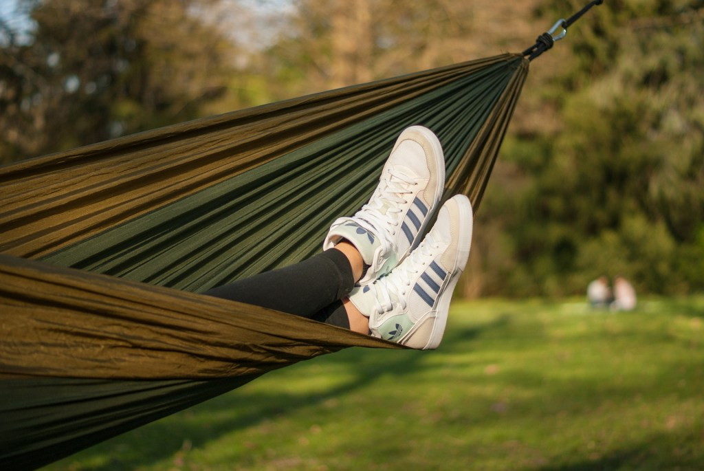 Feet relaxing in a hammock that is a cheaper alternative to Eno.