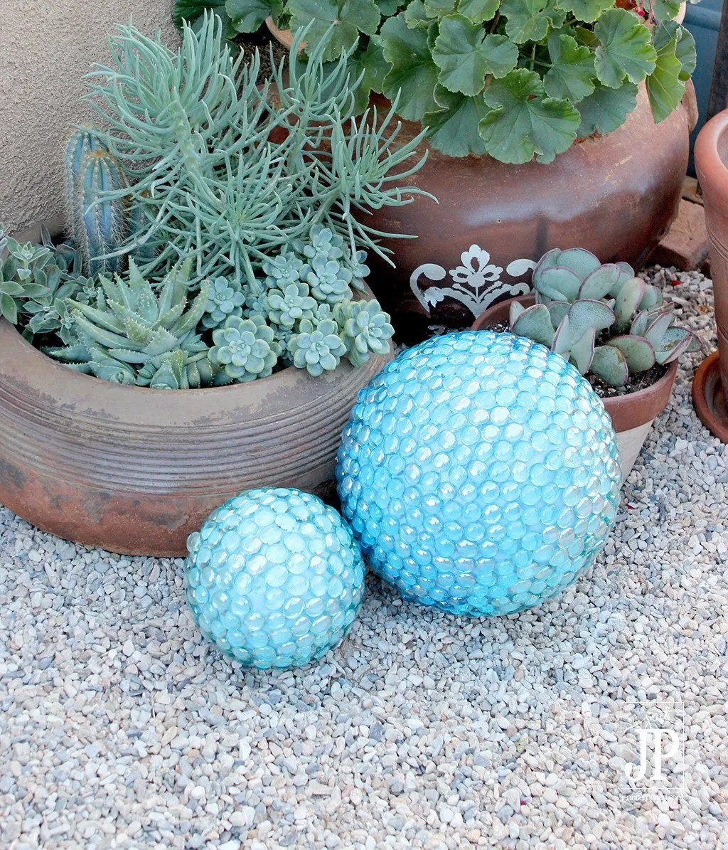 Jennifer shows how to make these fun faux gazing ball for your garden using Smoothfoam balls and half balls, mosaic pebbles, and acrylic paint!