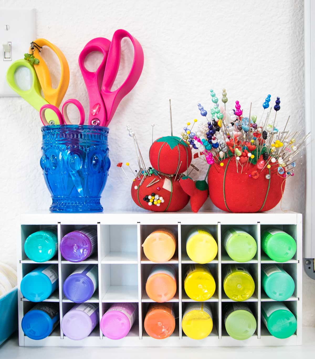 Paint storage box from artbin with cup of scissors and pin cushions on top