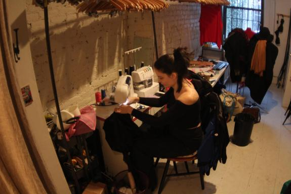 Mallorie Dunn of SmartGlamour sits at her sewing machine, making custom clothing