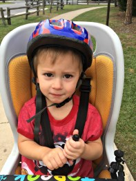 Asher in bike seat