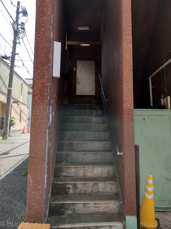 A door at the end of the stairs