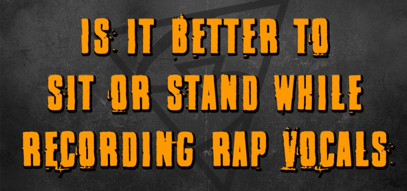 Is it better to sit or stand while recording rap vocals