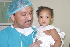 Dr Balaji with a Cleft Baby