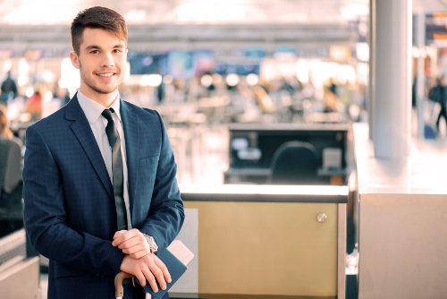 Business traveller holding passport