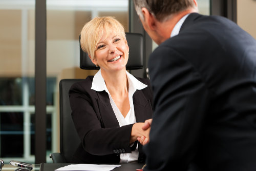 Business and commercial solicitor working with a client