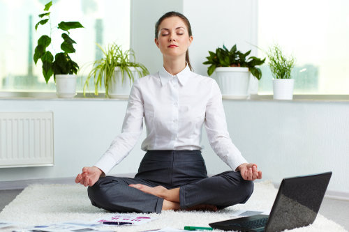 Meditating business woman