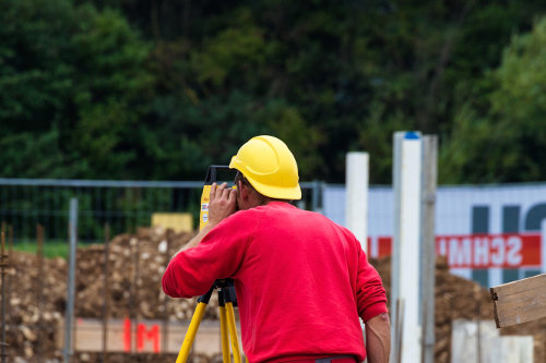 Surveying construction worker