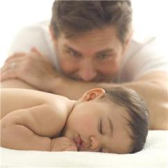 Image parent watching a baby sleep and grow like entrepreneurs watches a business