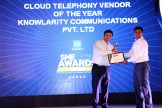 MR. KAMAN CHAULA, COUNTRY CATEGORY MANAGER VOLUME LASERS, HP INDIA SALES PVT. LTD IS GIVING THE AWARD OF BEST CLOUD TELEPHONY VENDOR OF THE YEAR TO KNOWLARITY COMMUNICATIONS