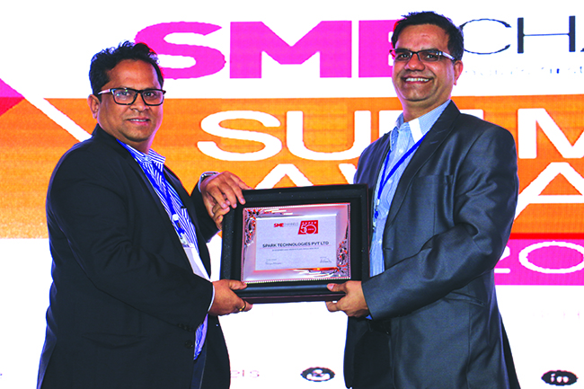 SANJAY MOHAPATRA OF SME CHANNELS GIVING AWAY SUPER50 AWARD TO SPARK TECHNOLOGIES PVT LTD