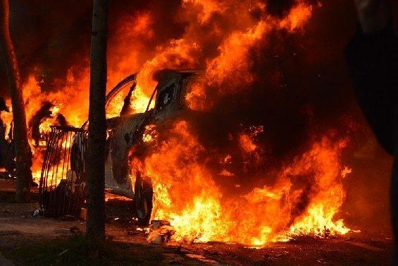 car burning in riot