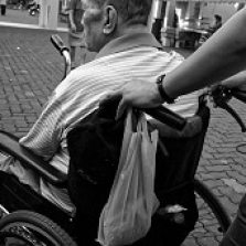 Wheelchair being pushed