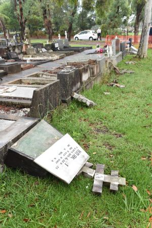 Vandals knocked over gravestones at Rookwood Cemetery.