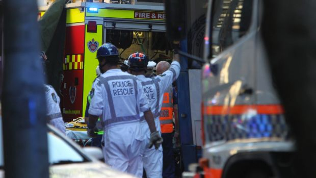 Emergency services work to free Christine Mulholland, who died in hospital after being hit by a bus on Clarence Street.