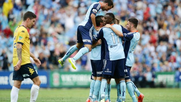 Joy and despair: Sydney FC players celebrate, while the Mariners were left to rue missed opportunities.