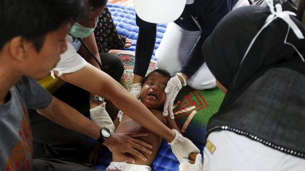 A Rohingya child, who arrived in Indonesia this week by boat, receives medical treatment for an eye infection at a temporary shelter near Langsa in Indonesia's Aceh Province.