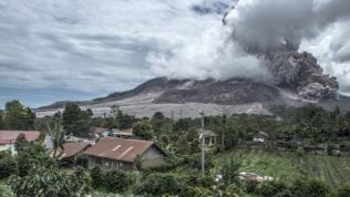 Mount Sinabung spews ash as seen from the nearest village in Karo district, North Sumatra.