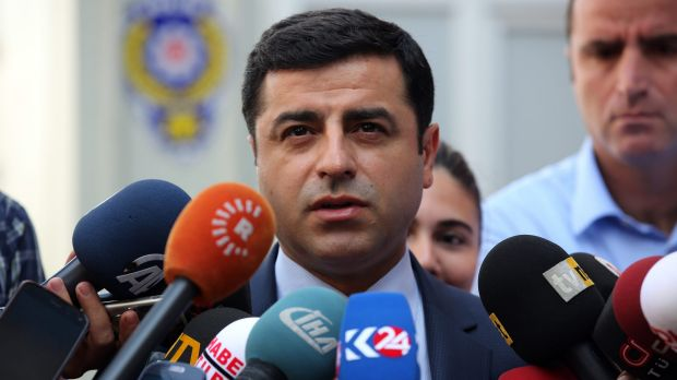 Pro-Kurdish Peoples Democracy Party leader Selahattin Demirtas speaks to the media about Turkey's air strikes against Kurdish rebel bases in Iraq on Monday.
