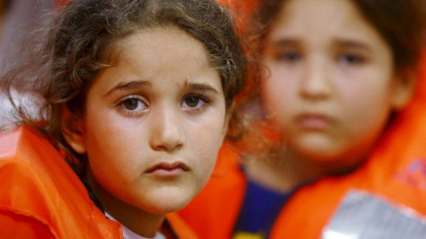 Children on a Migrant Offshore Aid Station ship wait to be transferred to a Norwegian ship off the coast of Libya in August.