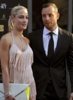 Before the storm: Oscar Pistorius and Reeva Steenkamp in 2012.