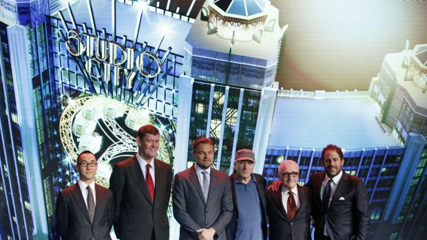 Melco Crown Entertainment's co-chairman and chief executive officer Lawrence Ho and co-chairman James Packer pose with film stars Leonardo DiCaprio, Robert De Niro, director Martin Scorsese and producer Brett Ratner at the Studio City Casino launch in Macau.