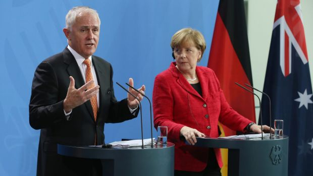 Prime Minister Malcolm Turnbull addresses the media with German Chancellor Angela Merkel following talks at the Chancellery. Turnbull said 'there needs to be a political solution' in Syria.