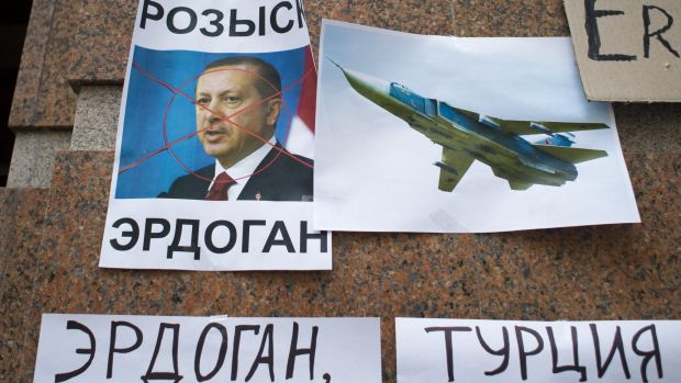 """Russian anger: posters showing a portrait of Turkish President Recep Tayyip Erdogan and reading """"Wanted Erdogan"""",""""Erdogan"""", and """"Turkey"""", left after a protest at the Turkish embassy in Moscow."""