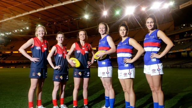 AFL and Women?s Exhibition Match players at Etihad Stadium today - from left Phoebe McWilliams , Alicia Eva , Daisy Pearce , Aasta O