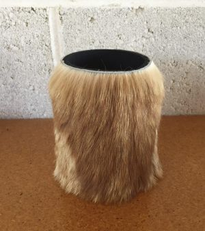 A catskin stubby holder made by Barry Green.