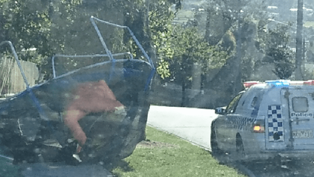 A Trampoline has a police escort as it makes it