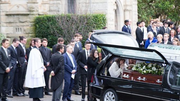 A mother's farewell: Kathy Kelly blows a kiss to her son Stuart Kelly's coffin.