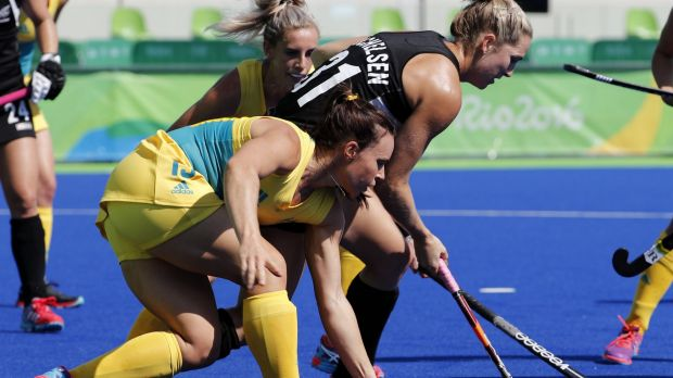 Sorry: Georgie Parker fights for the ball with New Zealand's Stacey Michelsen.