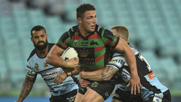 Dominant: Rabbitohs star Sam Burgess holds off the Cronulla defence.