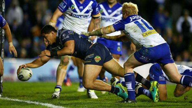 Unstoppable: Jason Taumalolo stretches to touch down for a try.